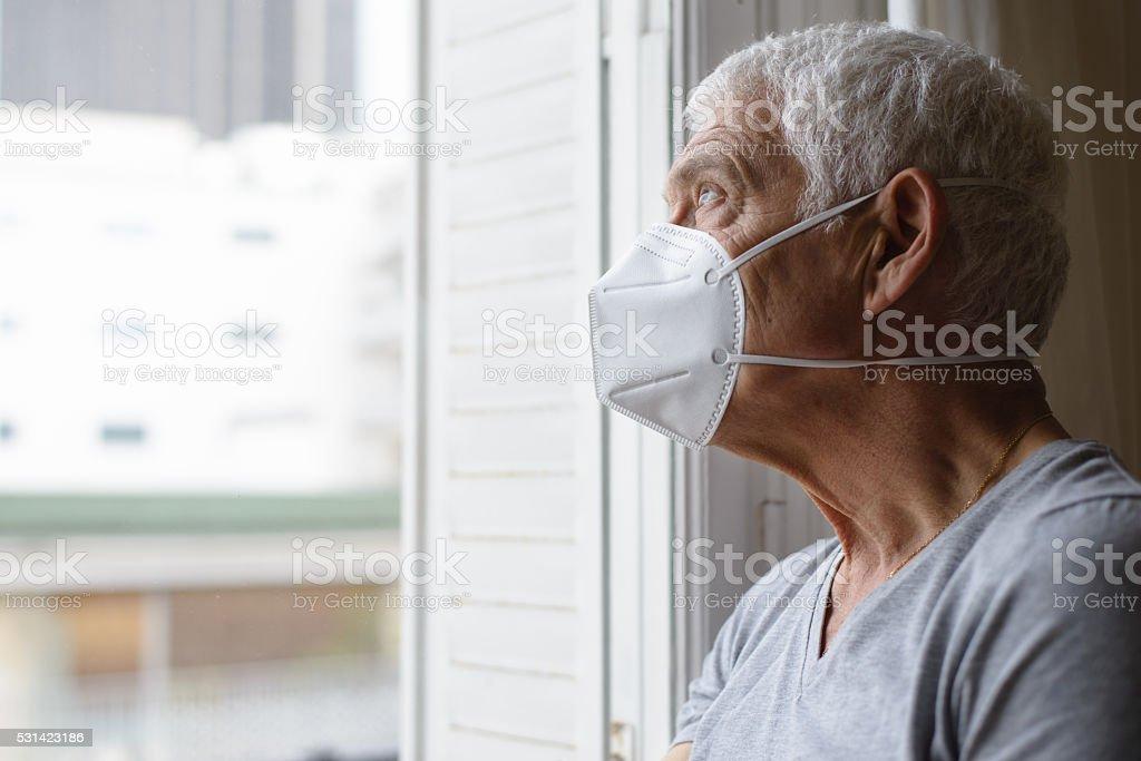 Senior Man Wearing Air Filter Mask stock photo