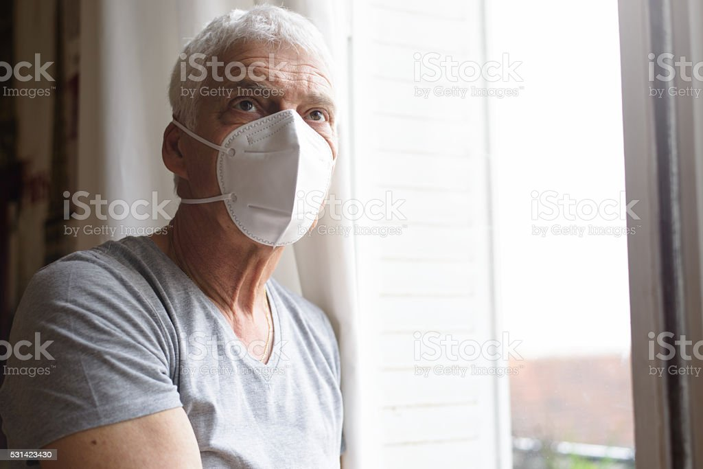 Senior Man Wearing Air Filter Mask stock photo