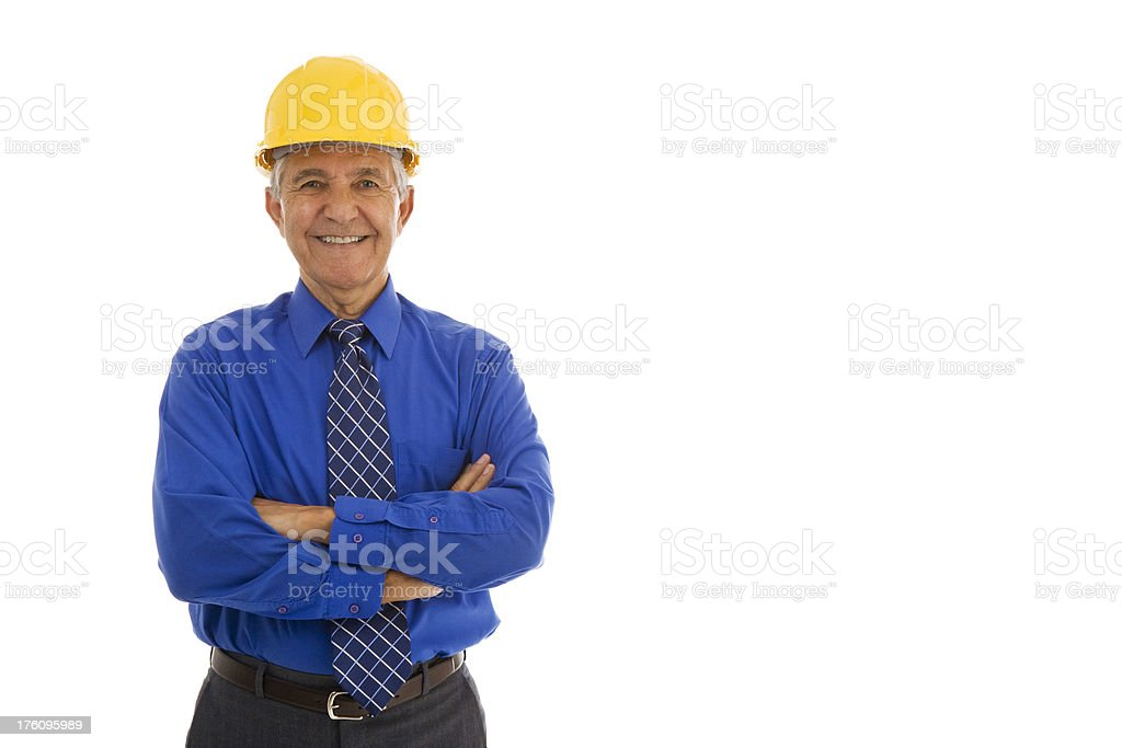 Senior man wearing hardhat and shirt tie arms crossed royalty-free stock photo