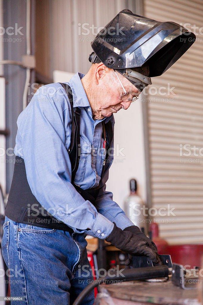 Senior Man Welding in Workshop stock photo