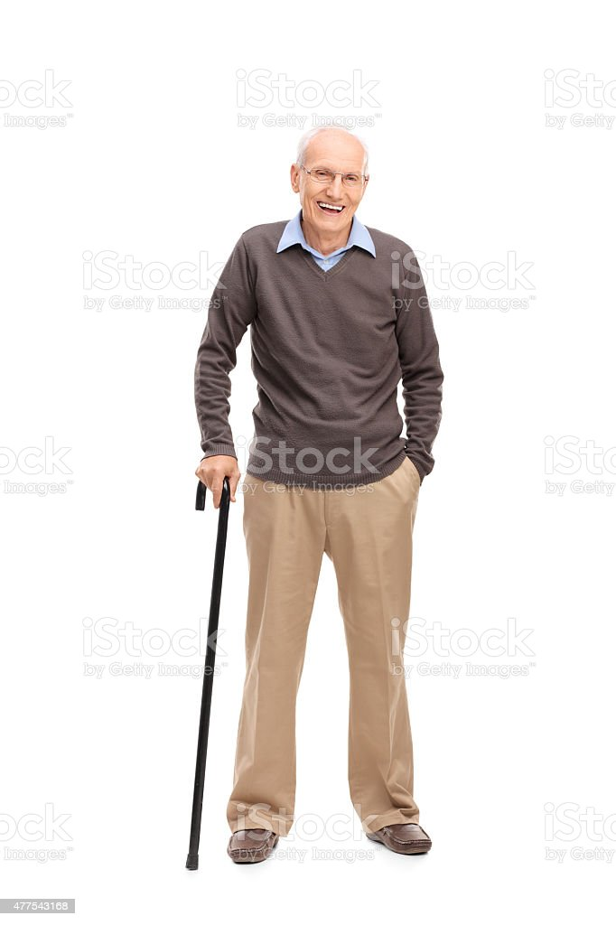 Senior man with a cane smiling and posing stock photo