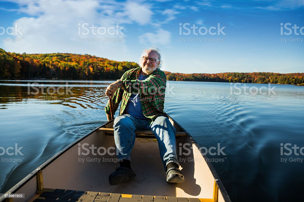 Senior man with a canoe in Algonquin Park - Canada stock photo