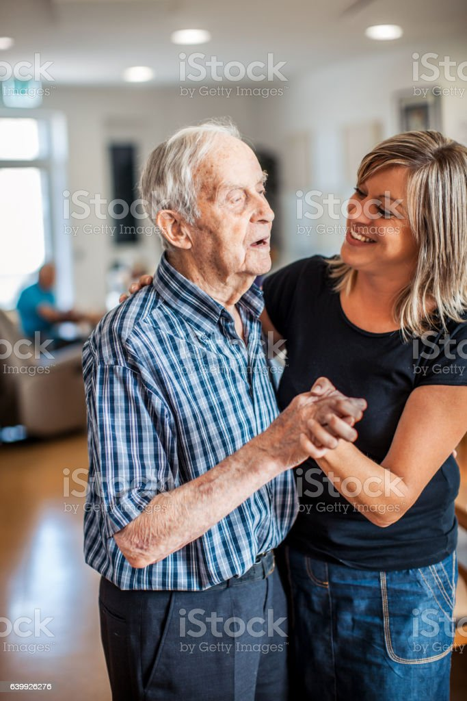 Senior Man with a Caregiver in an Elderly Daycare Center stock photo
