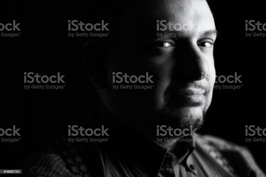 Senior man with a kind, good tempered look - chiaroscuro stock photo