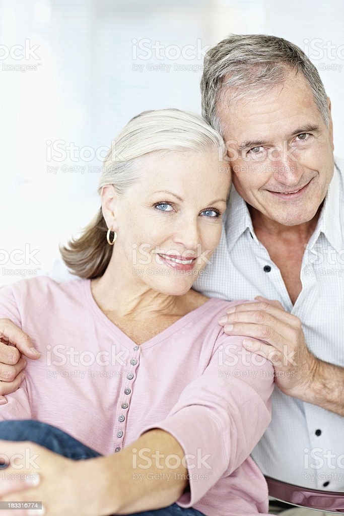 Senior man with a mature woman smiling together royalty-free stock photo