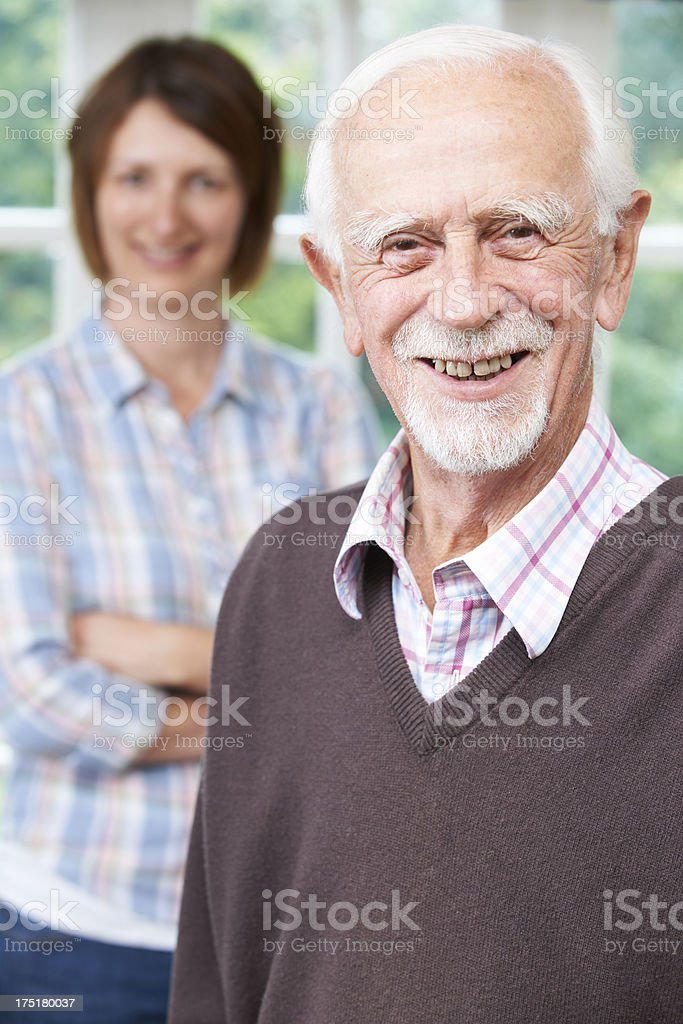 Senior Man With Adult Daughter At Home stock photo