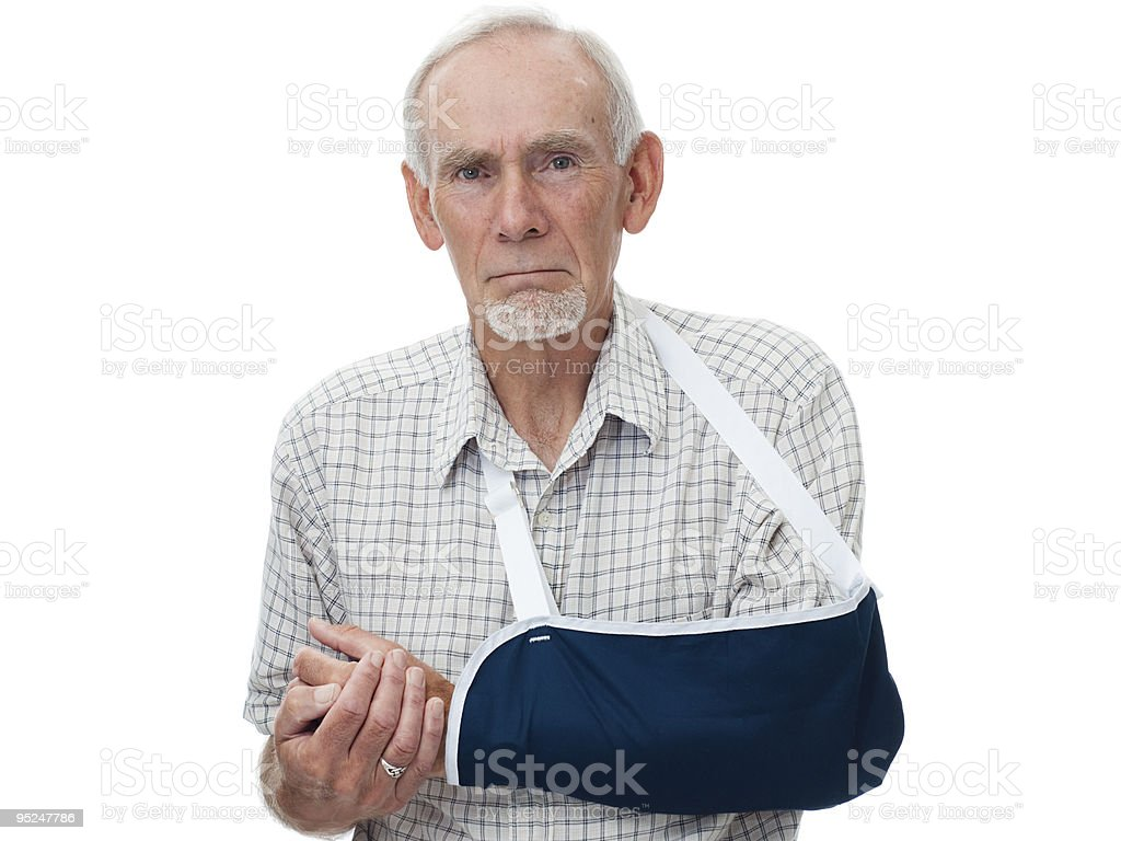 Senior man with arm in sling stock photo