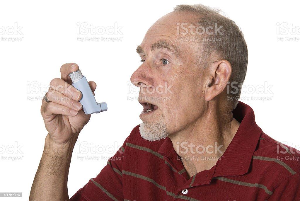 Senior man with asthma inhaler royalty-free stock photo