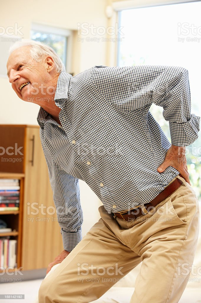 Senior man with backache royalty-free stock photo