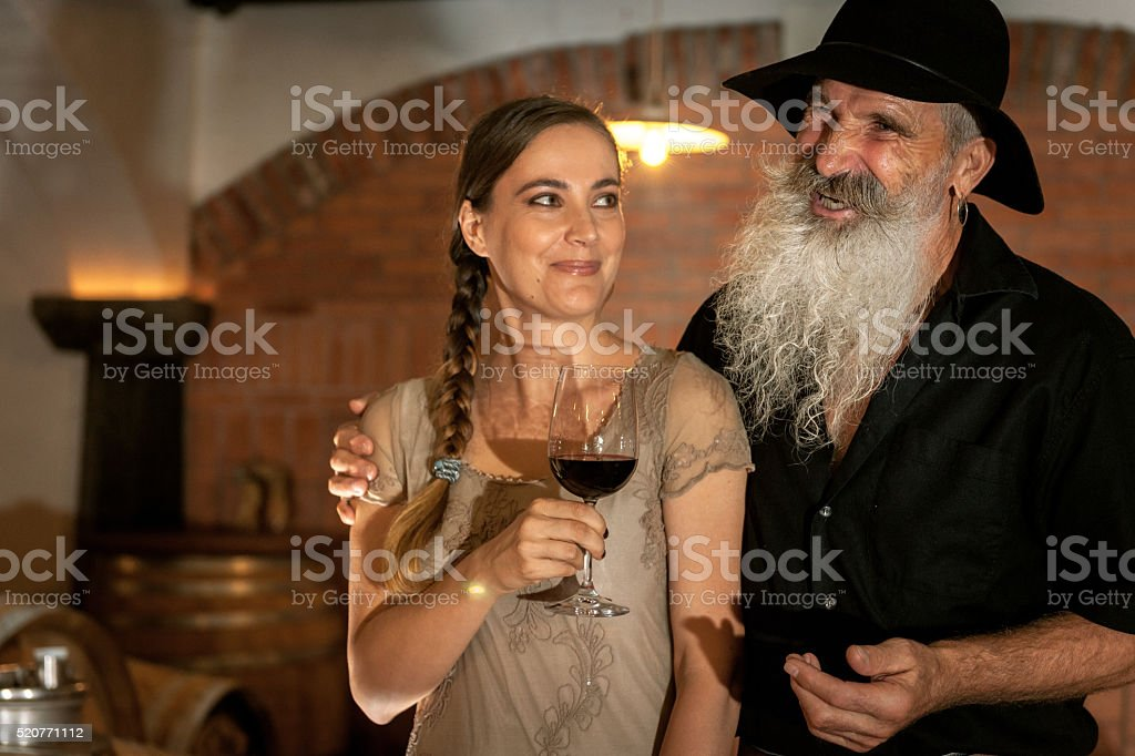 Senior Man with Beard and Young Woman in Cellar, Europe stock photo