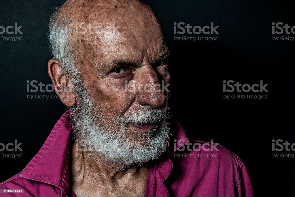 Senior man with white beard, serious and dark. California, USA.