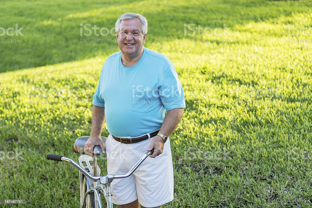 Senior man with bicycle royalty-free stock photo