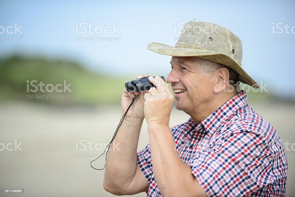 Senior Man with Binoculars royalty-free stock photo