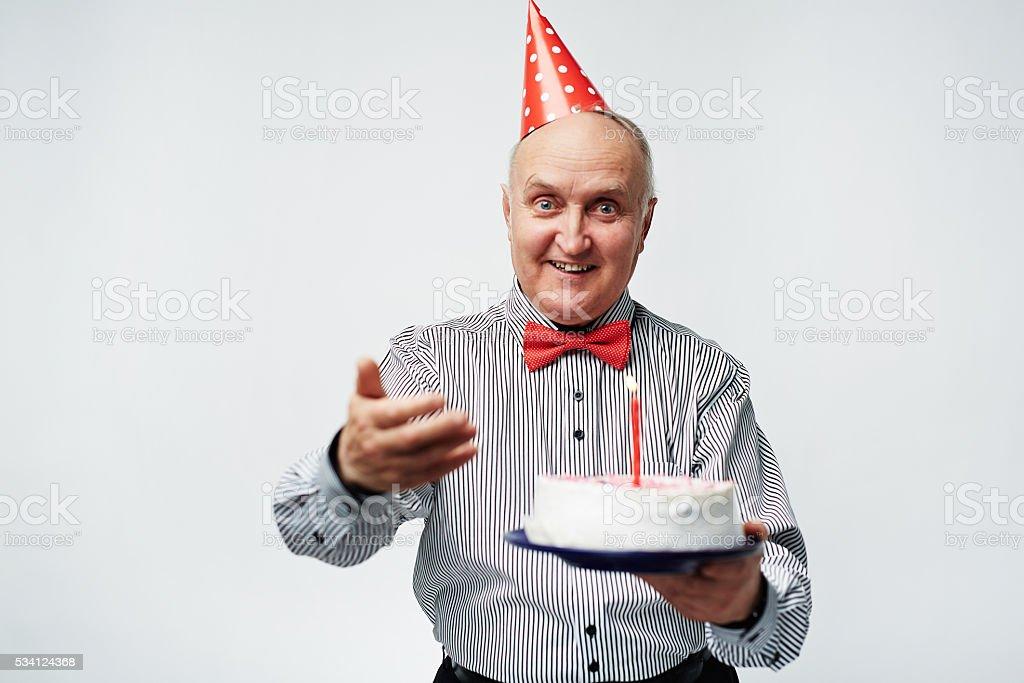 Senior man with cake stock photo
