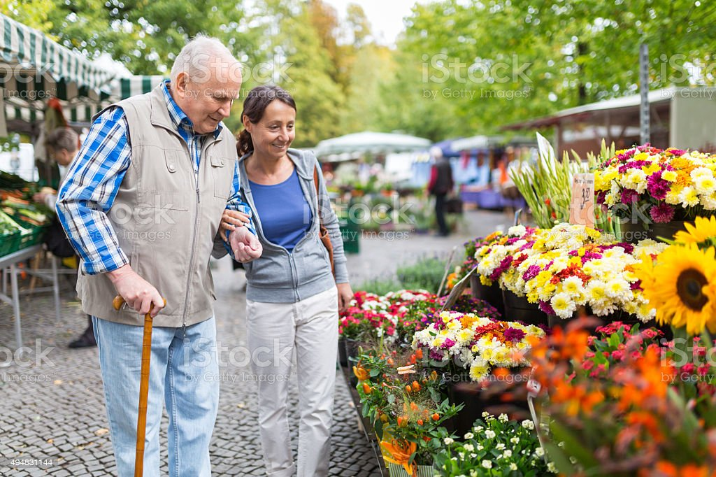 Senior man with caregiver shopping stock photo