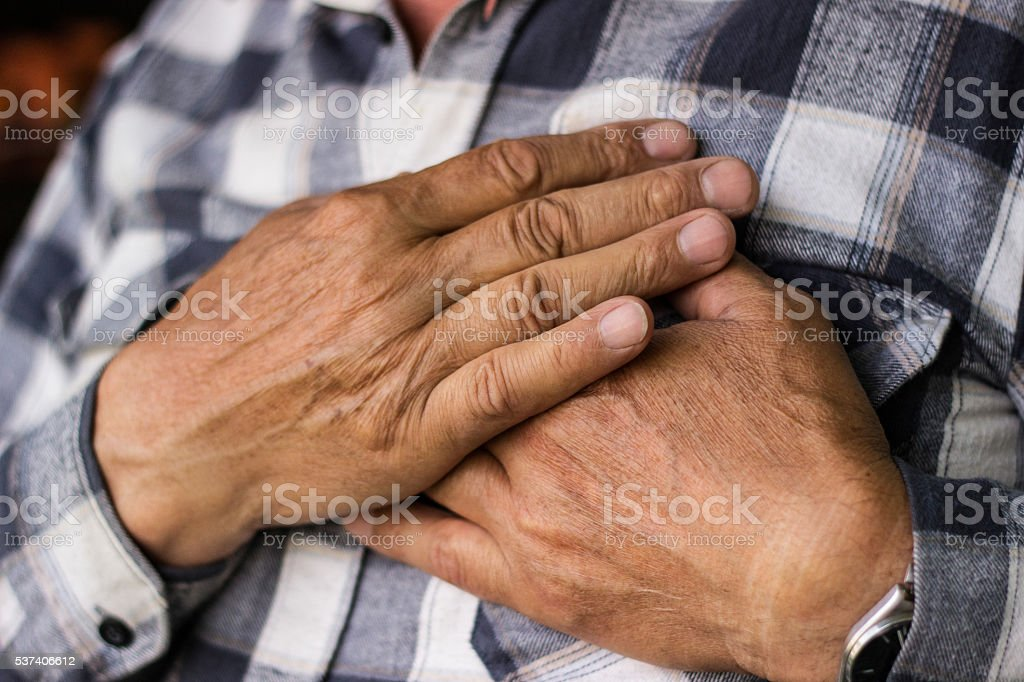 Senior man with chest pain stock photo