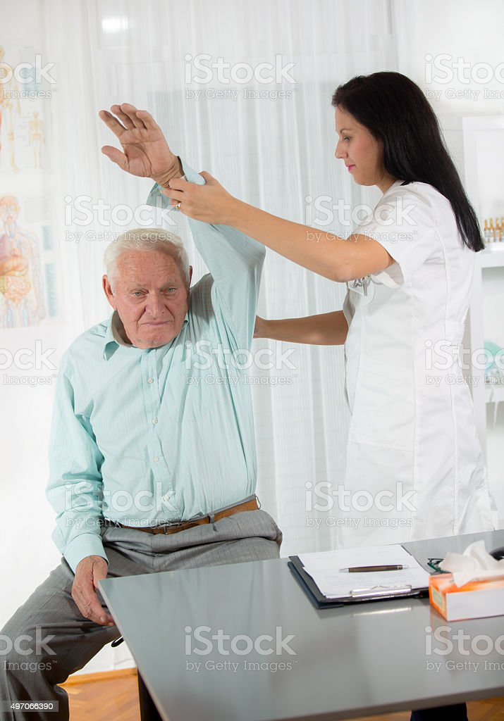 Senior Man with Chiropractor stock photo
