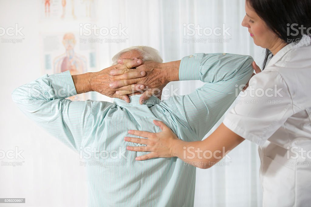 Senior Man with Chiropractor stock photo