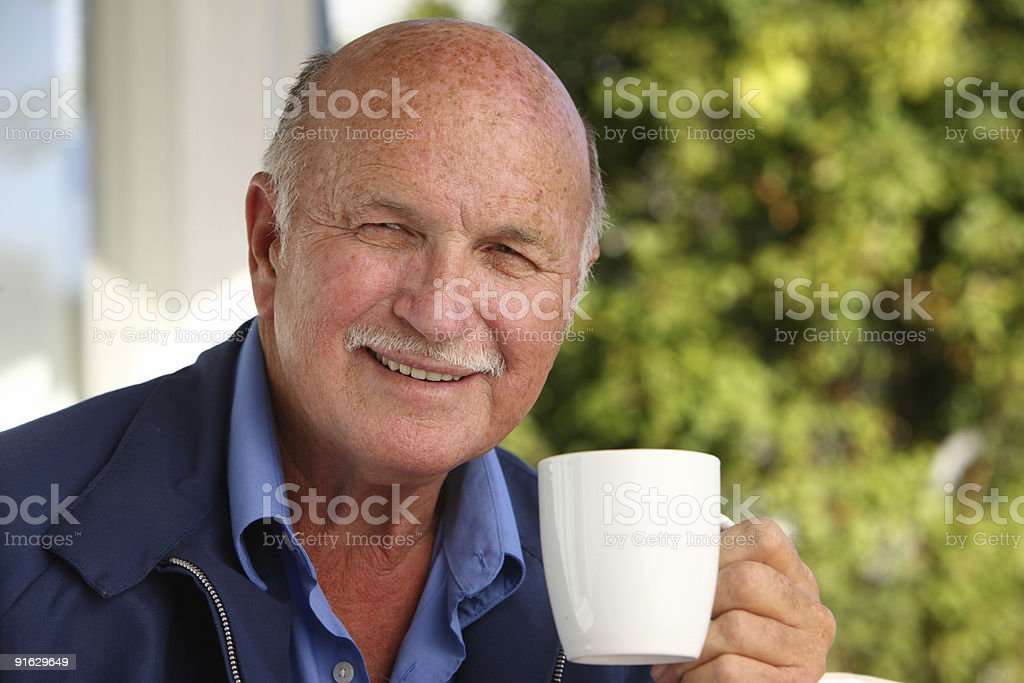 Senior man with coffee royalty-free stock photo
