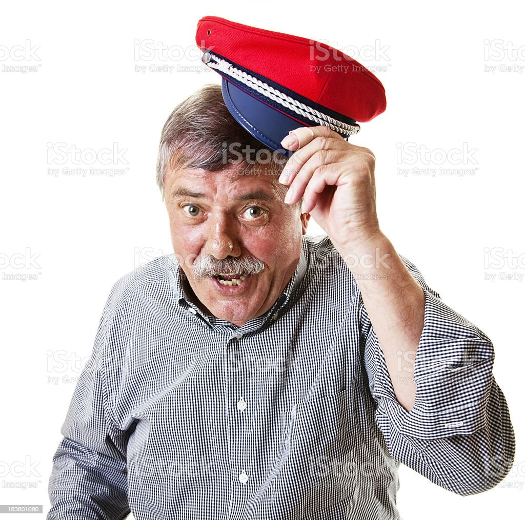 senior man with conductor hat stock photo