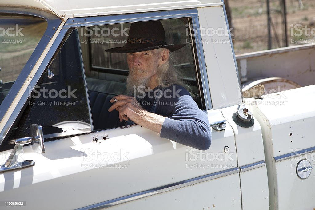 Senior Man With Cowboy Hat Sitting in Vehicle royalty-free stock photo