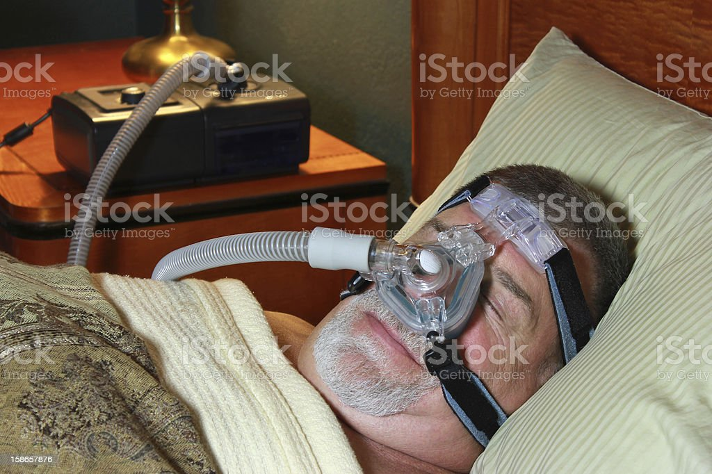 Senior Man with CPAP stock photo