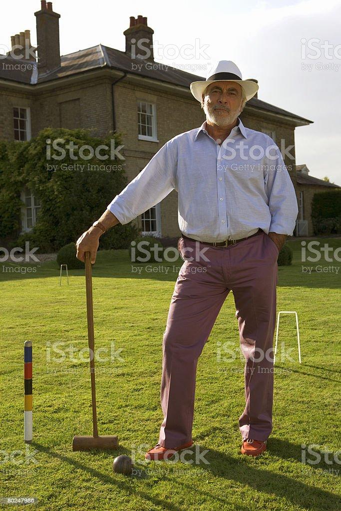 Senior man with croquet set. stock photo