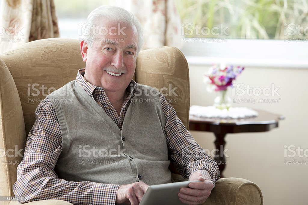 Senior Man With Digital Tablet stock photo