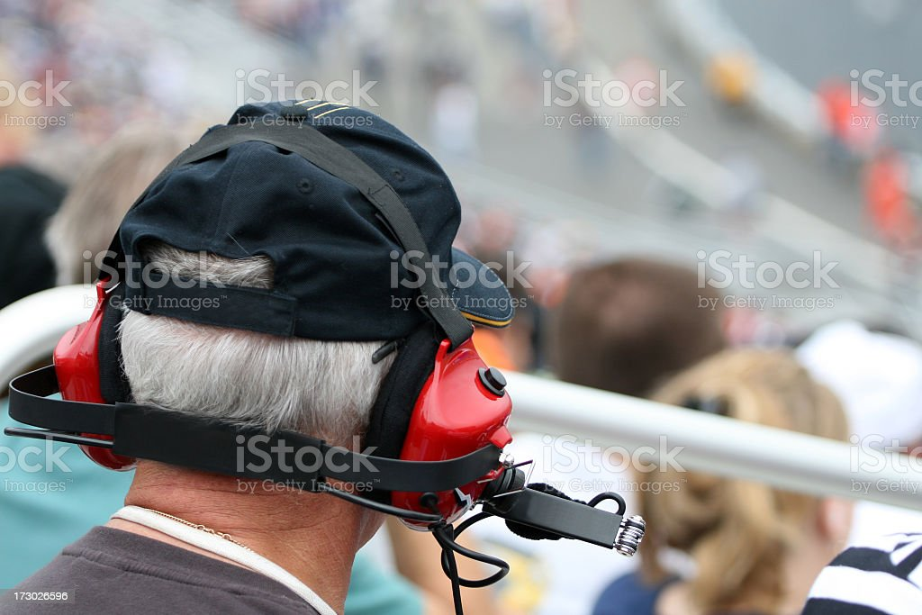 Senior Man With Earmuffs at Racing Event royalty-free stock photo
