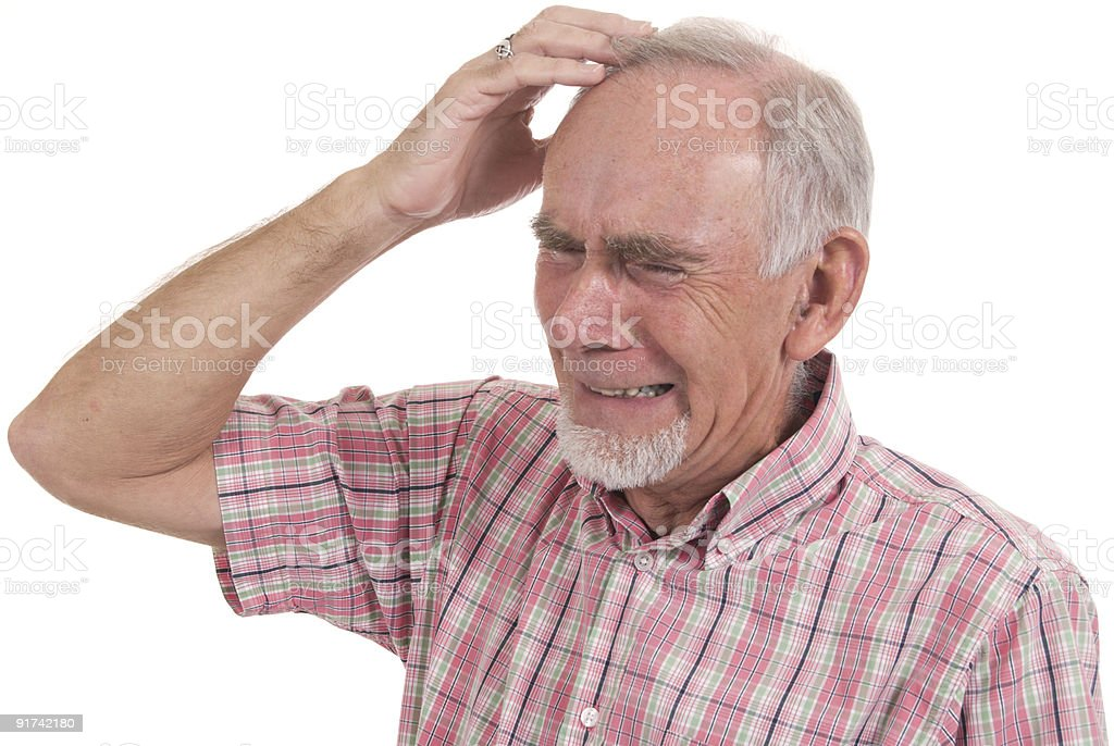 Senior man with expression of extreme anguish stock photo