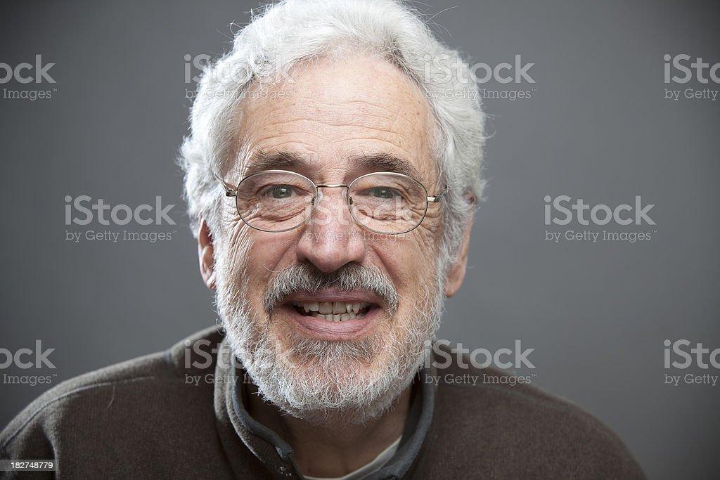 Senior Man with Glasses Looking at the Camera royalty-free stock photo