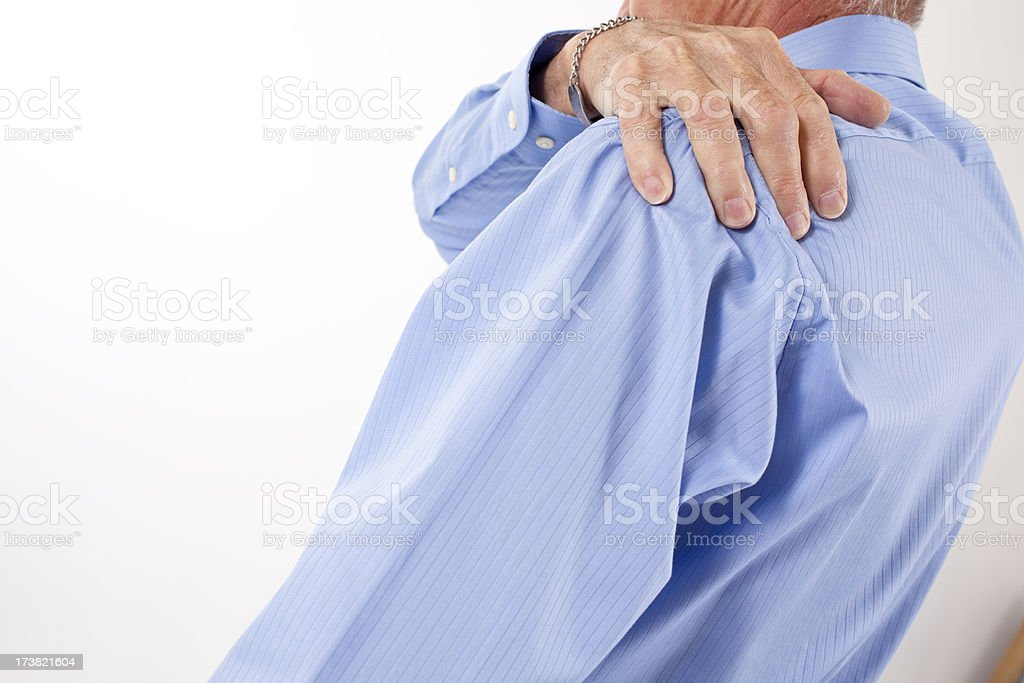 Senior man with hands rubbing shoulders and neck in pain royalty-free stock photo