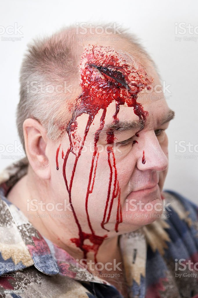 Senior man with head injury - laceration. Special effects make-up