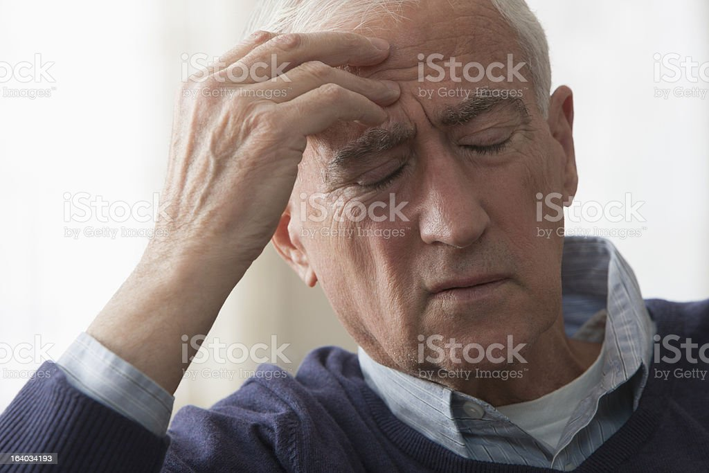 Senior man with headache royalty-free stock photo