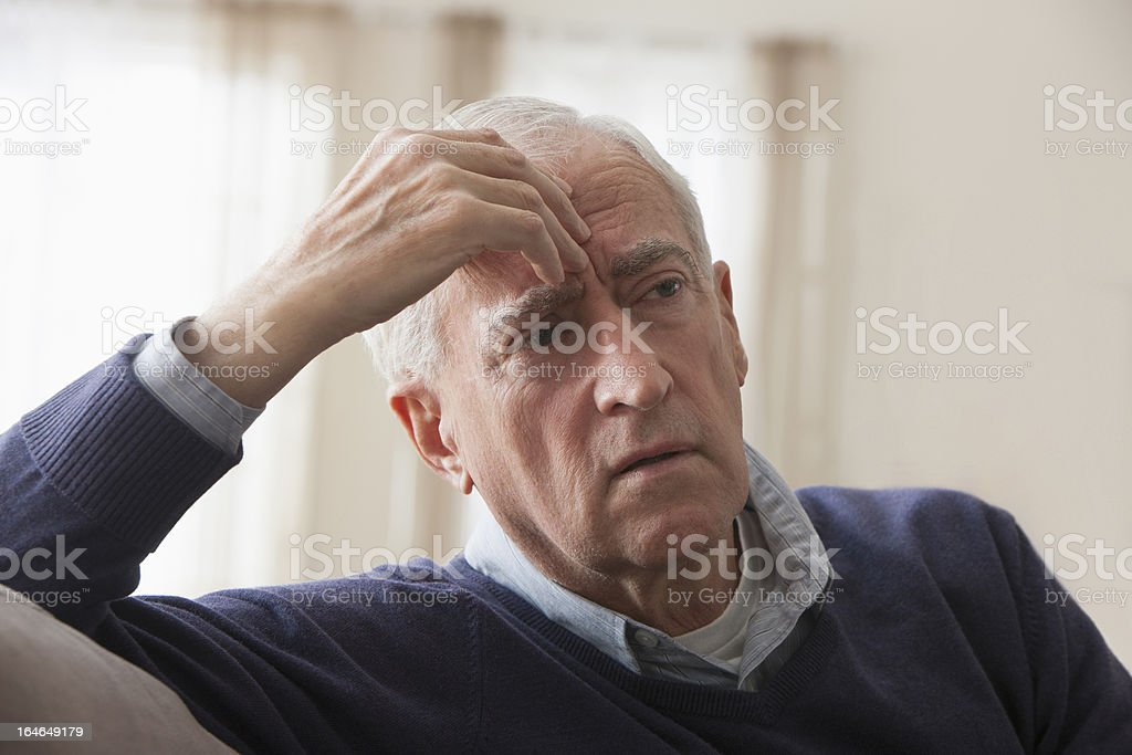 Senior man with headache royalty-free stock photo