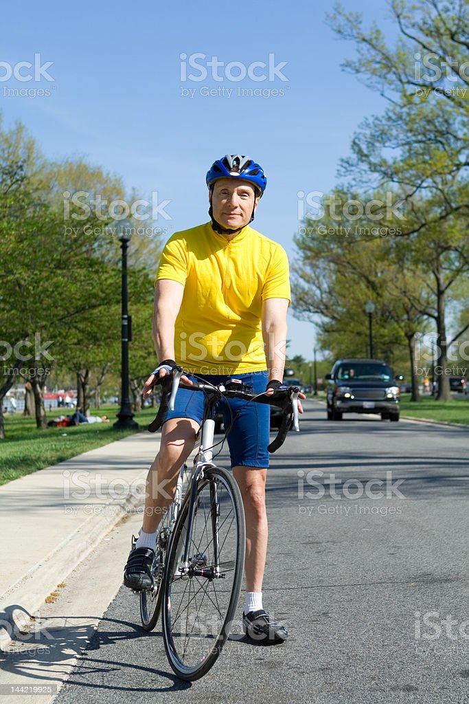 Senior Man With Helmet Sitting on a Bicycle royalty-free stock photo