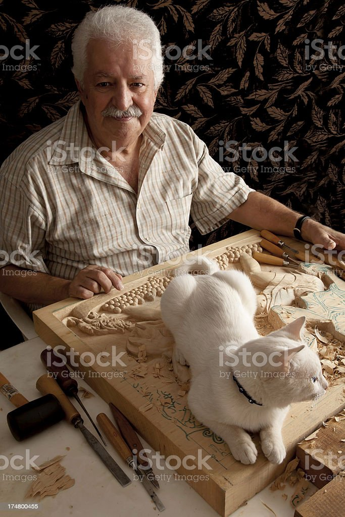 senior man with his cat royalty-free stock photo