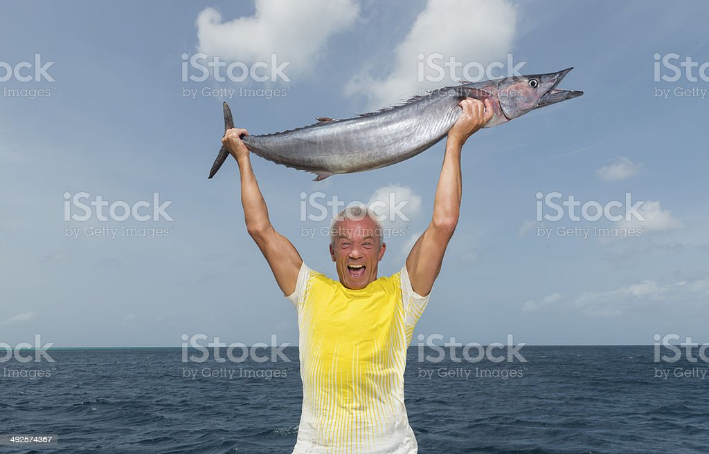 Senior Man With His Catch stock photo