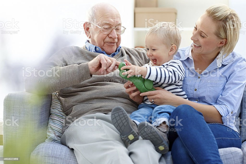 Senior man with his daughter and grand son stock photo