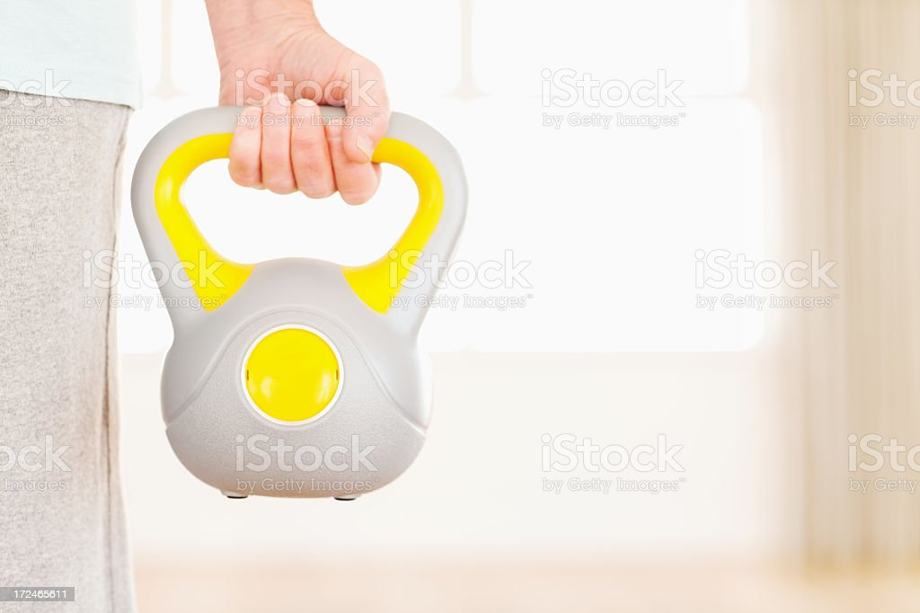 Senior Man With Kettle Bell royalty-free stock photo