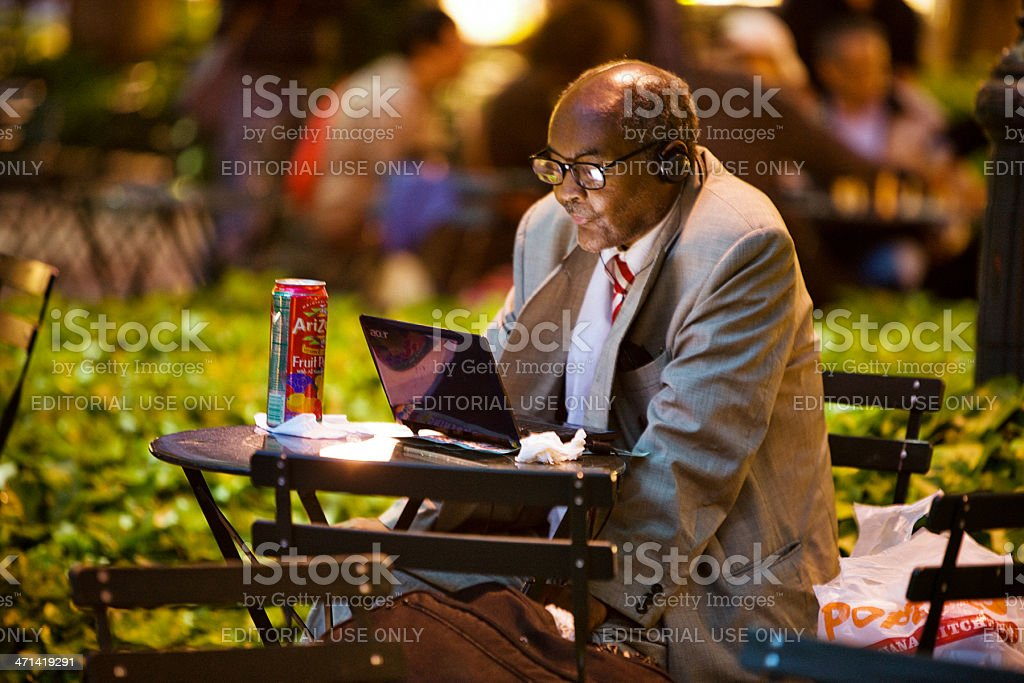 Senior Man with laptop in Bryant park, New York stock photo