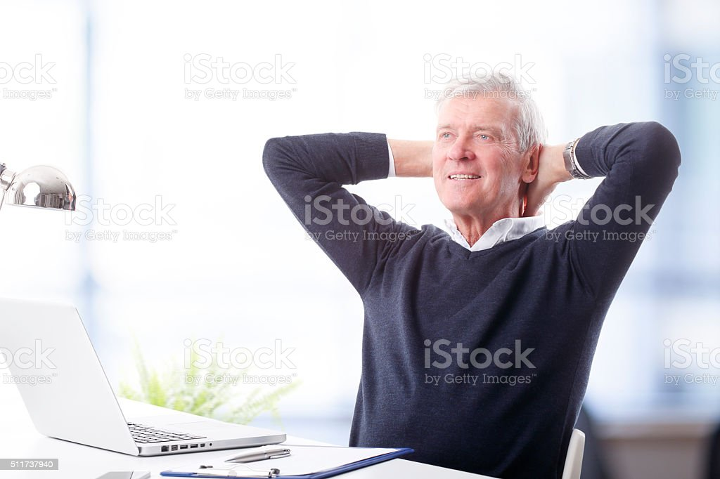 Senior man with laptop stock photo