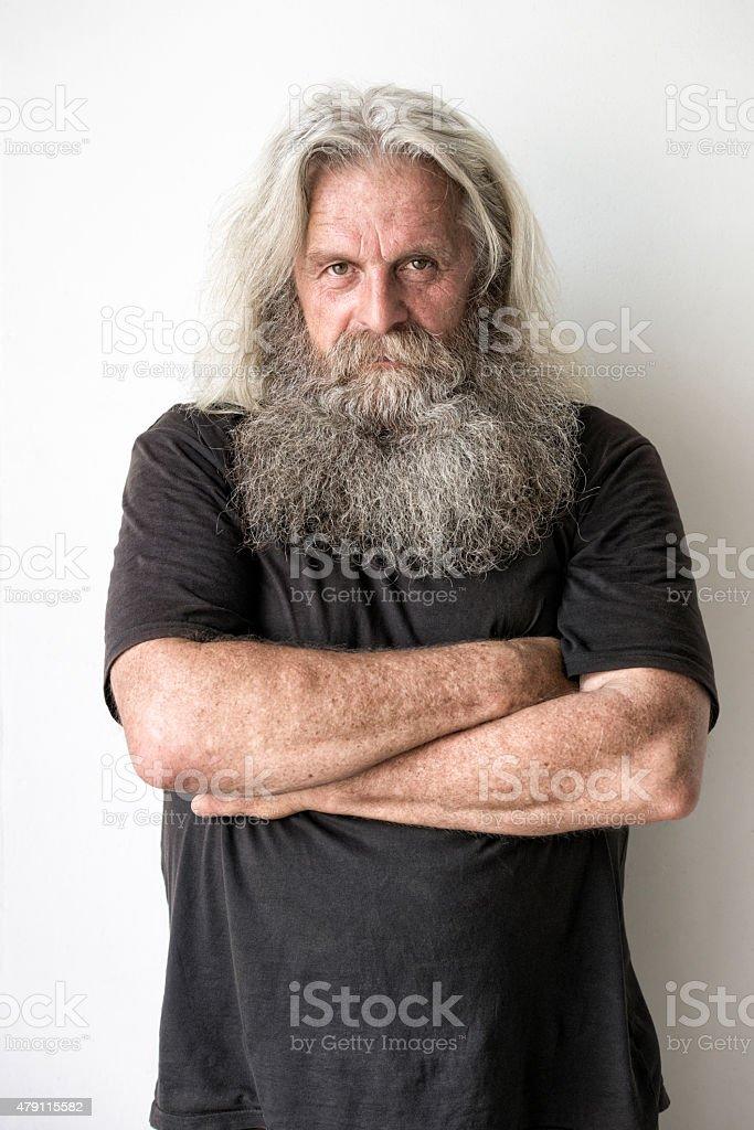 senior man with long hair and beard portrait stock photo