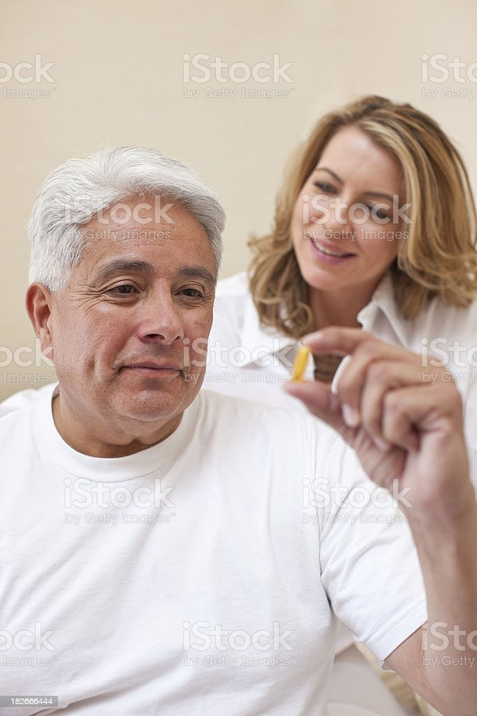 Senior man with medication royalty-free stock photo