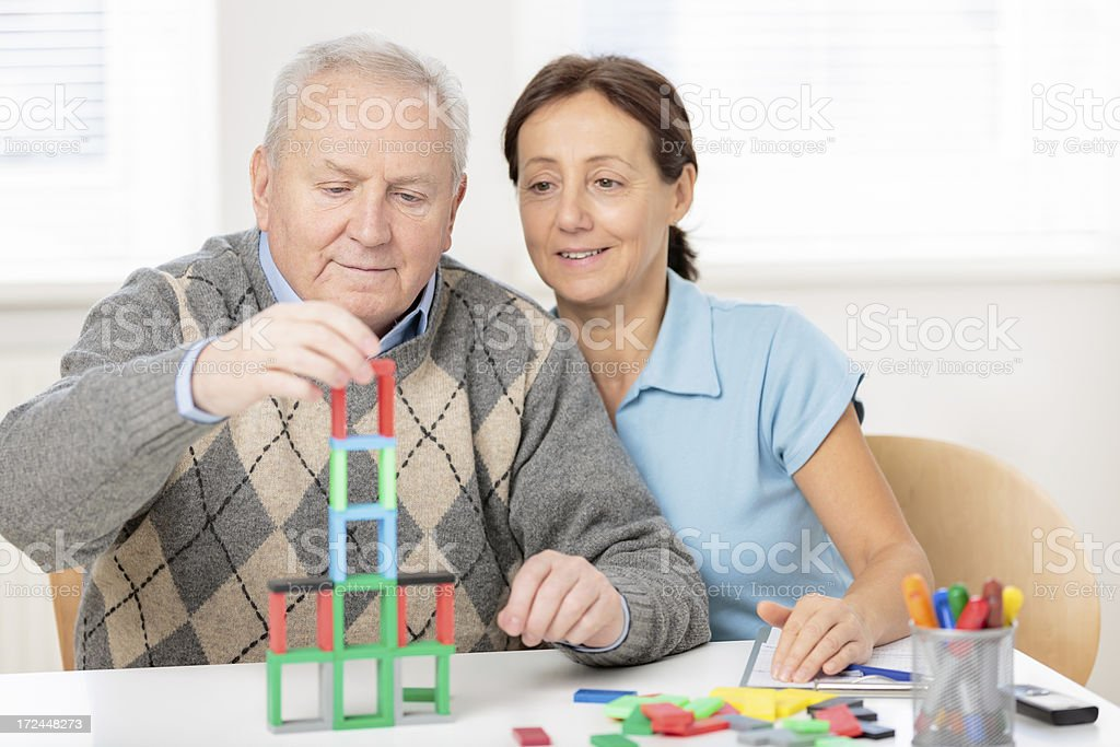 Senior man with occupational therapist stock photo