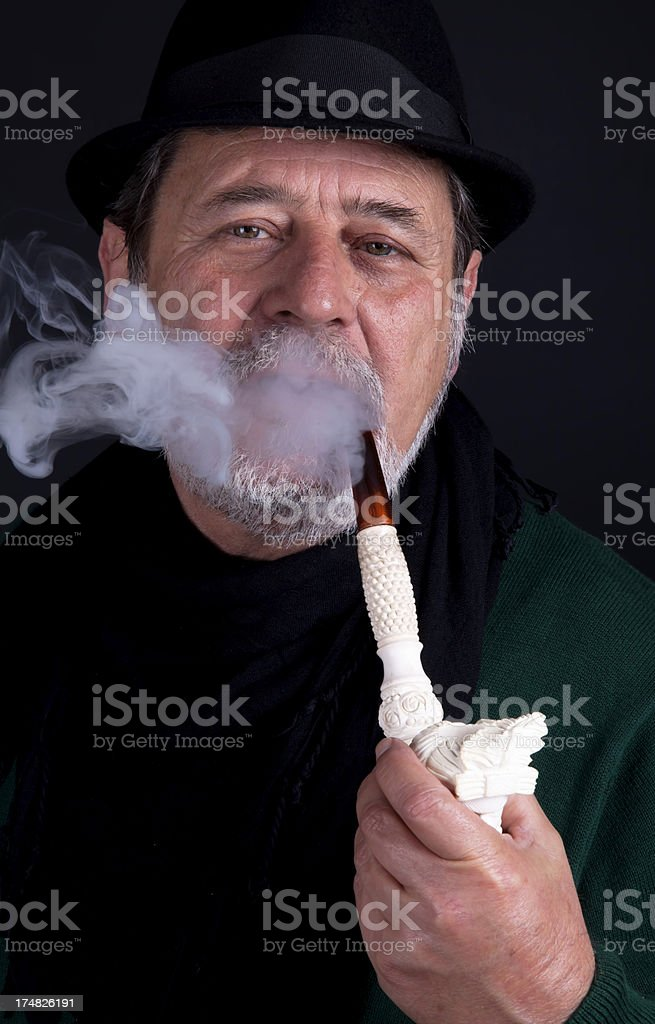 senior man with pipe royalty-free stock photo