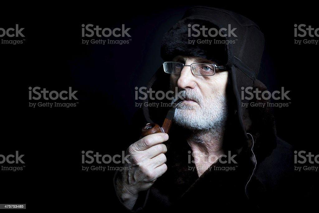 Senior man with pipe stock photo