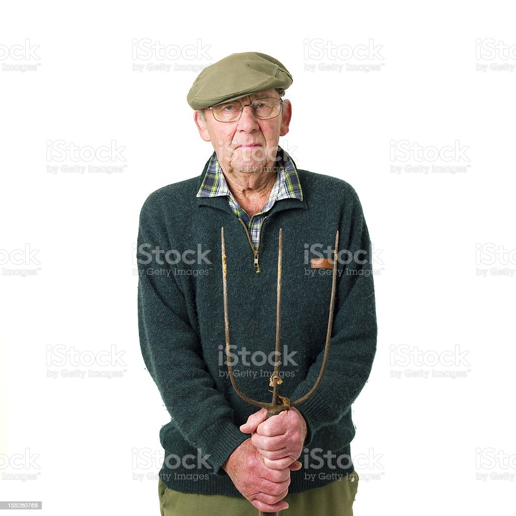 Senior man with pitch fork royalty-free stock photo