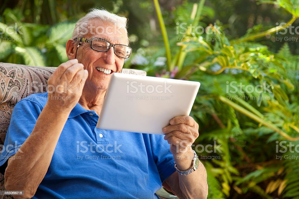 Senior Man with questioning gesture and Digital Tablet stock photo