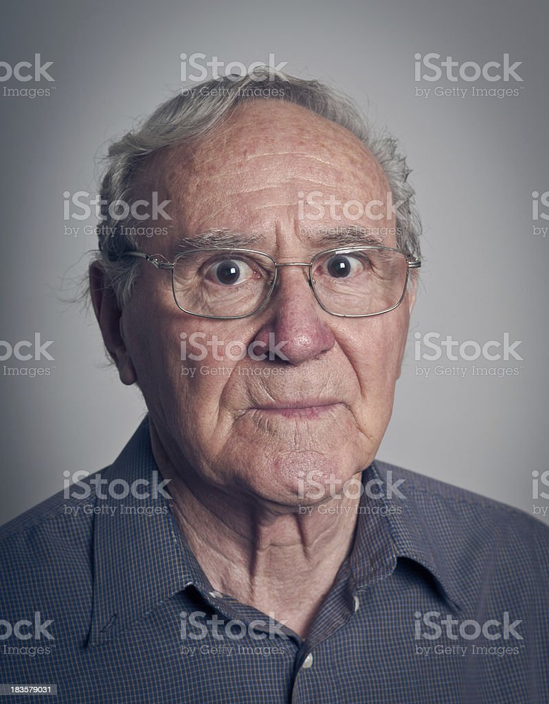 senior man with scared expression stock photo